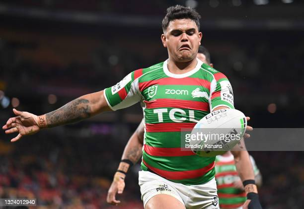 Latrell Mitchell of the Rabbitohs celebrates after scoring a try during the round 15 NRL match between the Brisbane Broncos and the South Sydney...