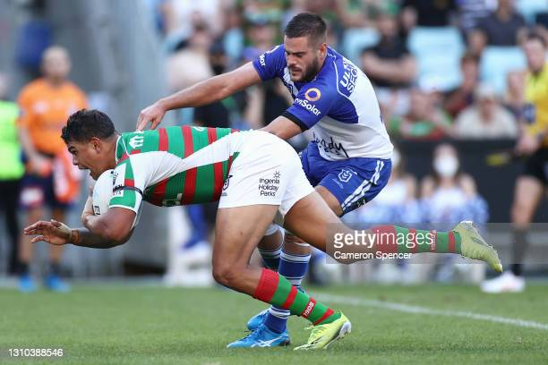 Latrell Mitchell of the Rabbitohs scores a try during the round four NRL match between the Canterbury Bulldogs and the South Sydney Rabbitohs at...