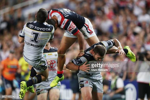 Latrell Mitchell of the Roosters and Lachlan Coote of the Cowboys compete for the ball in the air during the NRL Preliminary Final match between the...