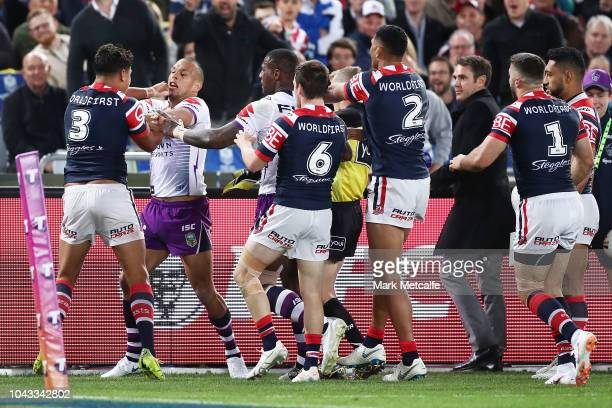 Latrell Mitchell of the Roosters and Will Chambers of the Storm tussle during the 2018 NRL Grand Final match between the Melbourne Storm and the...