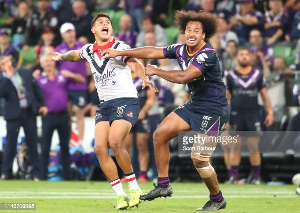 Latrell Mitchell of the Roosters celebrates after kicking the winning field goal during the round 6 NRL match between the Melbourne Storm and the...