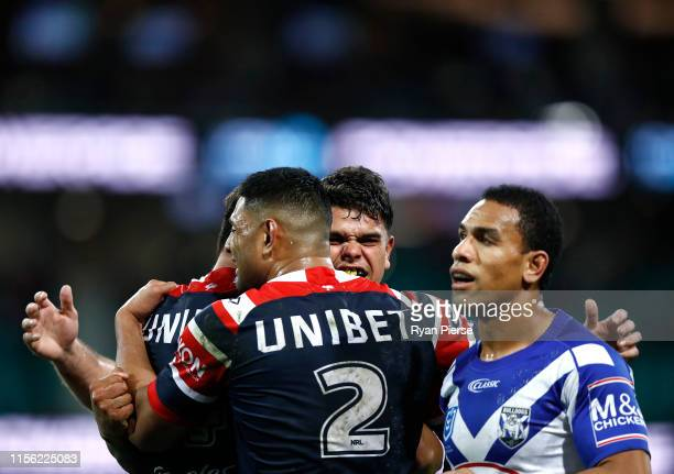 Latrell Mitchell of the Roosters celebrates after scoring a try during the round 14 NRL match between the Sydney Roosters and the Canterbury Bulldogs...