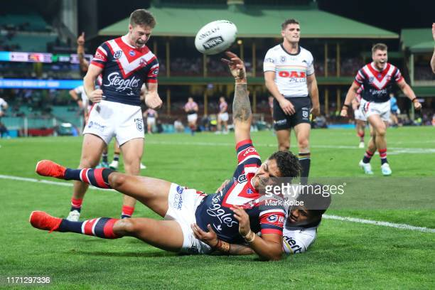 Latrell Mitchell of the Roosters celebrates scoring a try during the round 24 NRL match between the Sydney Roosters and the Penrith Panthers at...