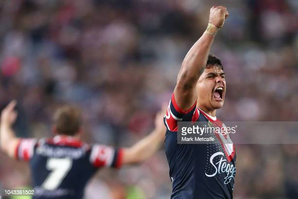 Latrell Mitchell of the Roosters celebrates victory in the 2018 NRL Grand Final match between the Melbourne Storm and the Sydney Roosters at ANZ...