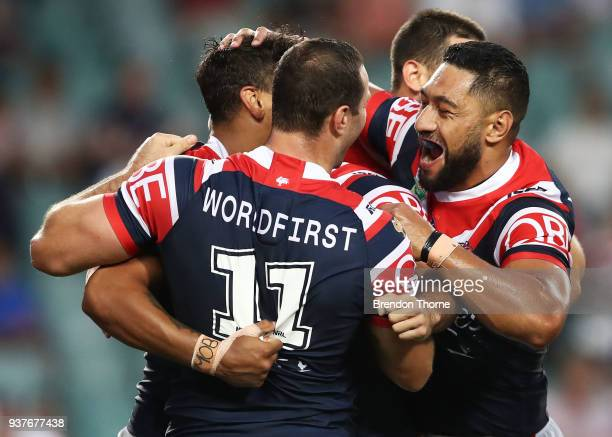 Latrell Mitchell of the Roosters celebrates with team mates after scoring a try during the round three NRL match between the Sydney Roosters and the...