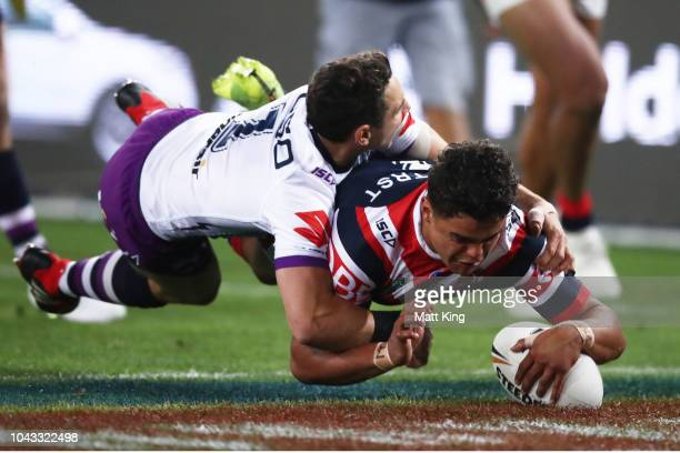 Latrell Mitchell of the Roosters dives over past Billy Slater of the Storm to score a try during the 2018 NRL Grand Final match between the Melbourne...