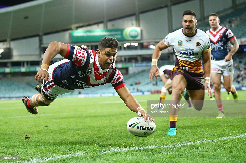 Latrell Mitchell of the Roosters dives to score a try during the round 21 NRL match between the Sydney Roosters and the Brisbane Broncos at Allianz Stadium on July 28, 2016 in Sydney, Australia.