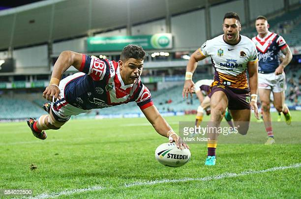 Latrell Mitchell of the Roosters dives to score a try during the round 21 NRL match between the Sydney Roosters and the Brisbane Broncos at Allianz...
