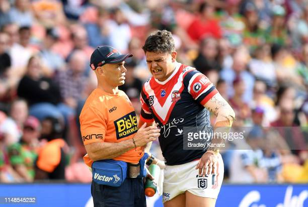 Latrell Mitchell of the Roosters is seen being taken from the field in pain during the round nine NRL match between the Sydney Roosters and the...