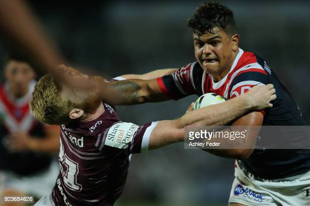 Latrell Mitchell of the Roosters is tackled by the Sea Eagles defence during the NRL Trial match between the Manly Sea Eagles and the Sydney Roosters...