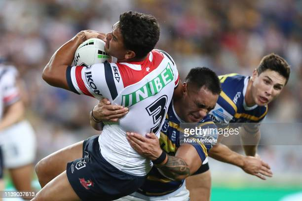 Latrell Mitchell of the Roosters is tackled during the round three NRL match between the Parramatta Eels and the Sydney Roosters at ANZ Stadium on...
