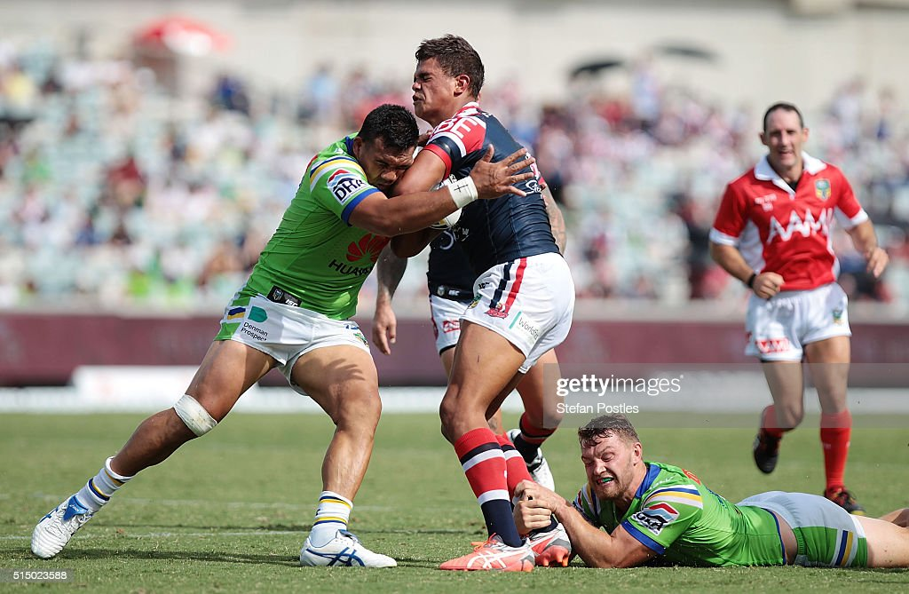 Latrell Mitchell of the Roosters is tackled during the round two NRL match between the Canberra Raiders and the Sydney Roosters at GIO Stadium on March 12, 2016 in Canberra, Australia.