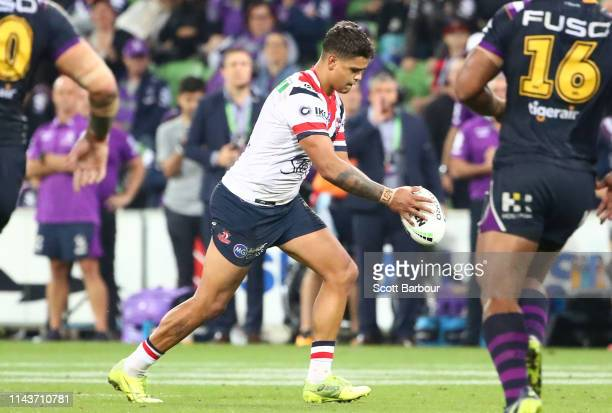 Latrell Mitchell of the Roosters kicks the winning field goal during the round 6 NRL match between the Melbourne Storm and the Sydney Roosters at...