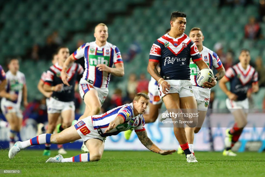 Latrell Mitchell of the Roosters makes a break during the round 20 NRL match between the Sydney Roosters and the Newcastle Knights at Allianz Stadium on July 21, 2017 in Sydney, Australia.