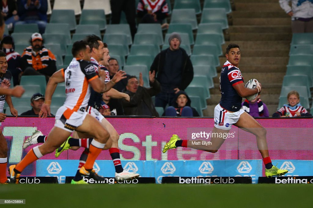 Latrell Mitchell of the Roosters makes a break during the round 24 NRL match between the Sydney Roosters and the Wests Tigers at Allianz Stadium on August 19, 2017 in Sydney, Australia.