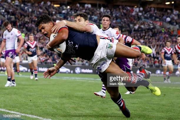 Latrell Mitchell of the Roosters scores a try during the 2018 NRL Grand Final match between the Melbourne Storm and the Sydney Roosters at ANZ...