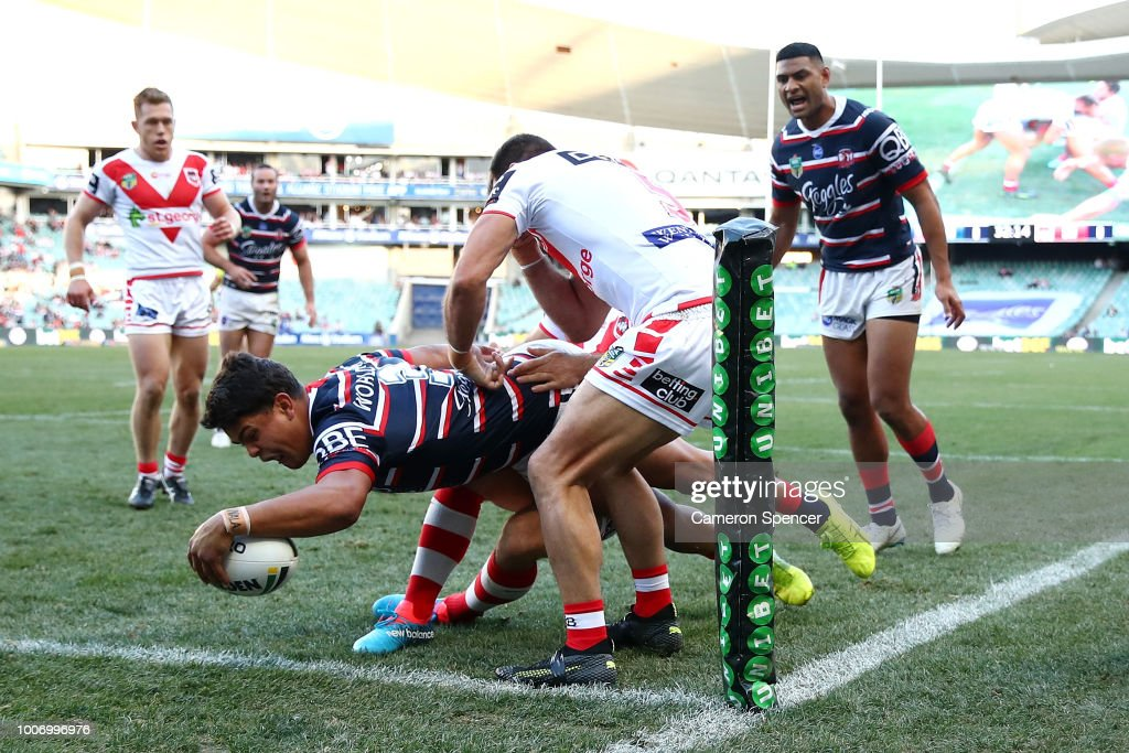 Latrell Mitchell of the Roosters scores a try during the round 20 NRL match between the Sydney Roosters and the St George Illawarra Dragons at Allianz Stadium on July 29, 2018 in Sydney, Australia.
