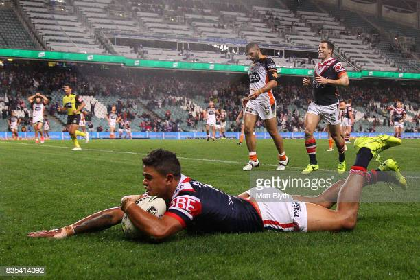 Latrell Mitchell of the Roosters scores a try during the round 24 NRL match between the Sydney Roosters and the Wests Tigers at Allianz Stadium on...