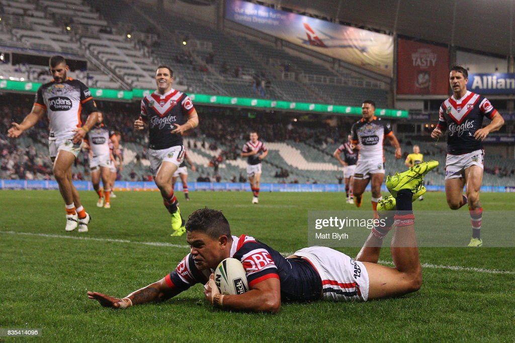 Latrell Mitchell of the Roosters scores a try during the round 24 NRL match between the Sydney Roosters and the Wests Tigers at Allianz Stadium on August 19, 2017 in Sydney, Australia.