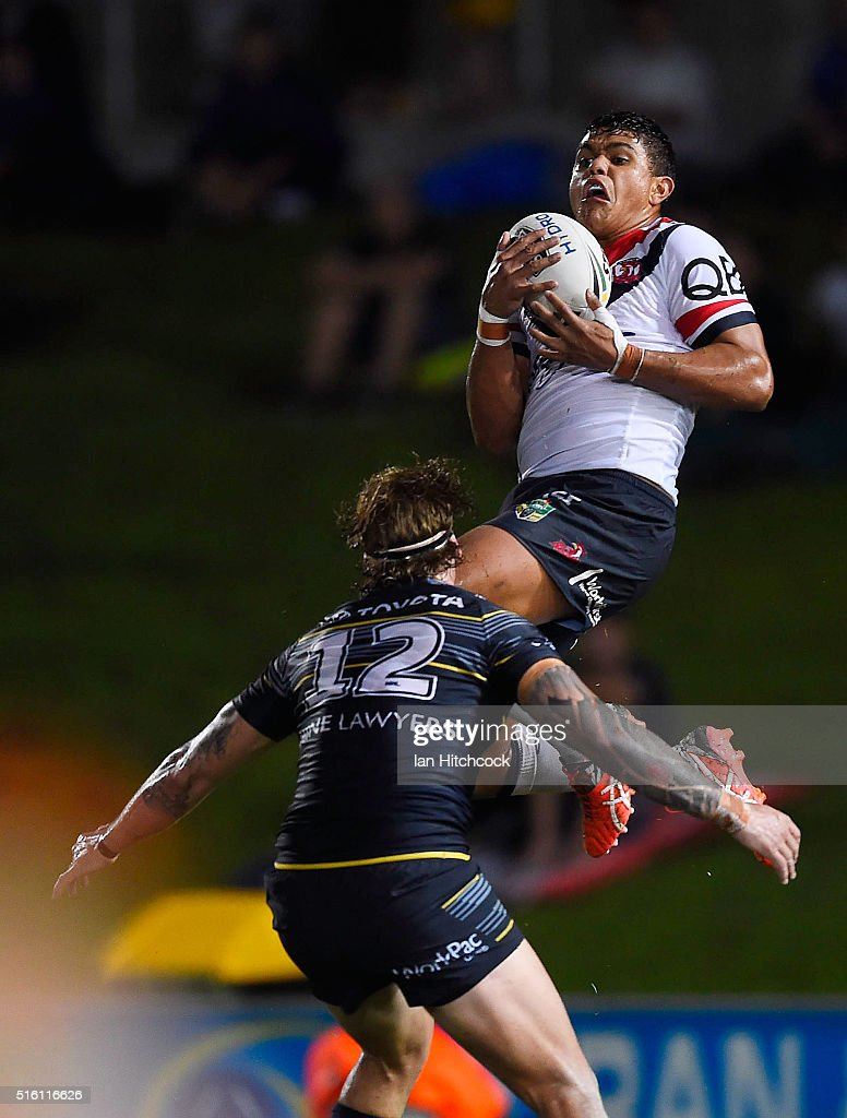 Latrell Mitchell of the Roosters takes a high ball in front of Ethan Lowe of the Cowboys during the round three NRL match between the North Queensland Cowboys and the Sydney Roosters at 1300SMILES Stadium on March 17, 2016 in Townsville, Australia.