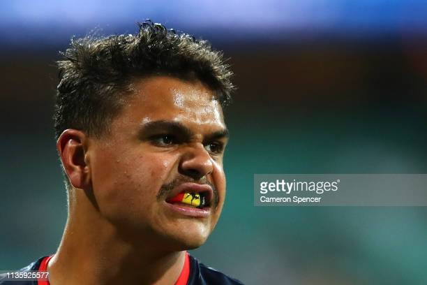Latrell Mitchell of the Roosters warms up ahead of the round one NRL match between the Sydney Roosters and the South Sydney Rabbitohs at Sydney...