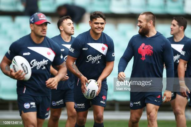 Latrell Mitchell warms up with team mates during a Sydney Roosters NRL training session at Allianz Stadium on September 24 2018 in Sydney Australia