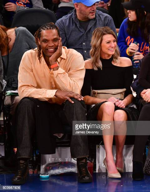 Latrell Sprewell and guest attend the New York Knicks vs Boston Celtics game at Madison Square Garden on February 24 2018 in New York City