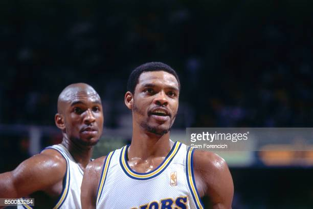 Latrell Sprewell and Joe Smith of the Golden State Warriors looks on circa 1997 at the Arena in Oakland in Oakland California NOTE TO USER User...