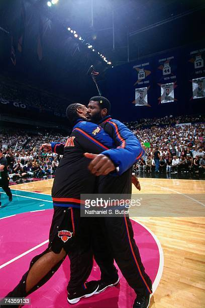 Latrell Sprewell and Larry Johnson of the New York Knicks chest bump each other during Game One of the 1999 NBA Finals played on June 16 1999 at the...