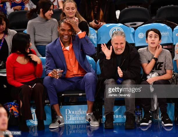 Latrell Sprewell Jon Stewart and Nathan Stewart attend New York Knicks vs Milwaukee Bucks game at Madison Square Garden on December 1 2018 in New...