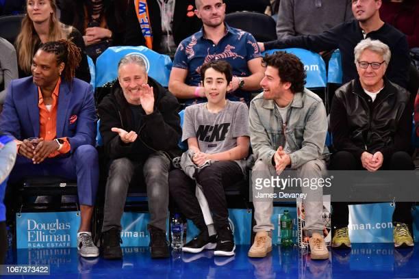 Latrell Sprewell Jon Stewart Nathan Stewart Jake Hoffman and Dustin Hoffman attend New York Knicks vs Milwaukee Bucks game at Madison Square Garden...