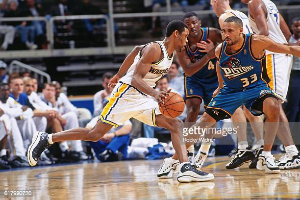 Latrell Sprewell of the Golden State Warriors dribbles against the Detroit Pistons circa 1997 at San Jose Arena in San Jose California NOTE TO USER...