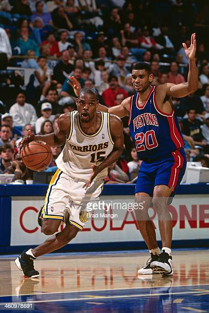 Latrell Sprewell of the Golden State Warriors dribbles the ball during a game played circa 1995 at the Oakland Coliseum in Oakland California NOTE TO...