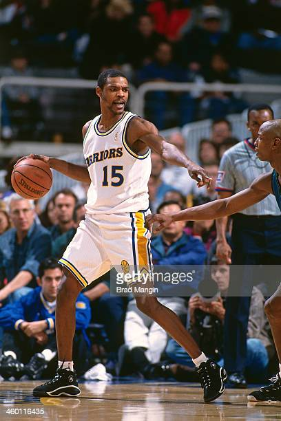 Latrell Sprewell of the Golden State Warriors dribbles the ball circa 1997 at the OaklandAlameda County Coliseum Arena in Oakland California NOTE TO...