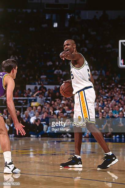 Latrell Sprewell of the Golden State Warriors dribbles the ball against the Utah Jazz during a game played circa 1995 at the Oakland Coliseum in...