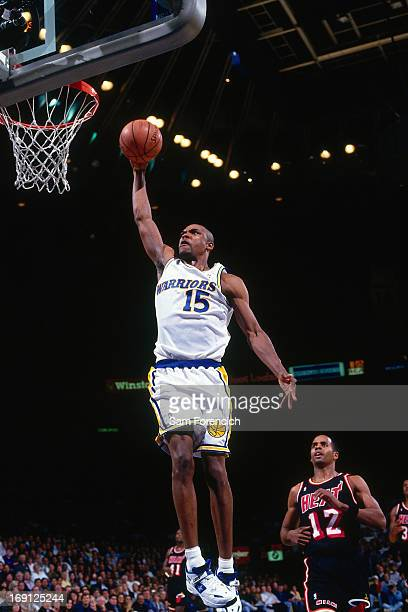 Latrell Sprewell of the Golden State Warriors dunks against the Miami Heat circa 1995 at the OaklandAlameda County Coliseum Arena in Oakland...