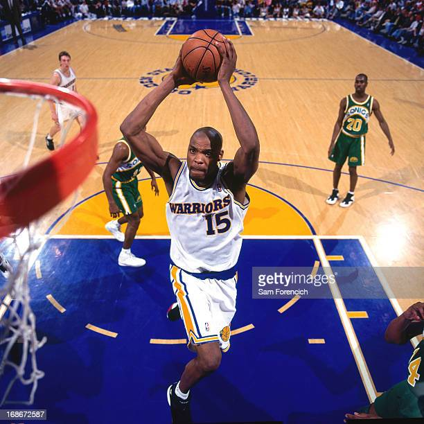 Latrell Sprewell of the Golden State Warriors dunks against the Seattle Supersonics circa 1995 at the OaklandAlameda County Coliseum Arena in Oakland...
