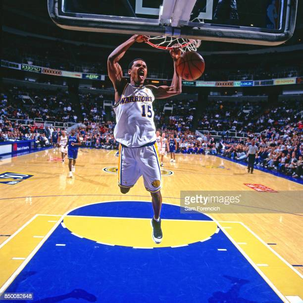 Latrell Sprewell of the Golden State Warriors dunks circa 1997 at the Arena in Oakland in Oakland California NOTE TO USER User expressly acknowledges...