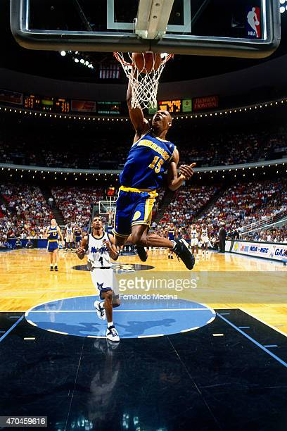 Latrell Sprewell of the Golden State Warriors dunks the ball against the Orlando Magic on March 26 1995 at the Orlando Arena in Orlando Florida NOTE...