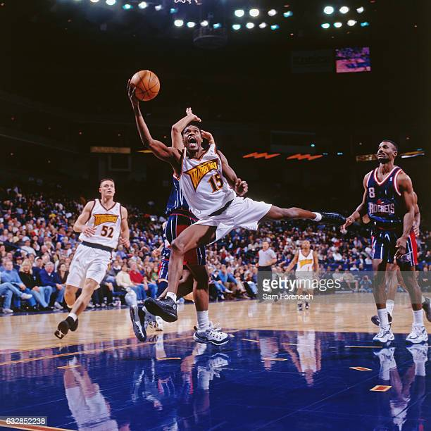 Latrell Sprewell of the Golden State Warriors shoots against the Houston Rockets during a game played on November 25 1997 at the Arena in Oakland in...