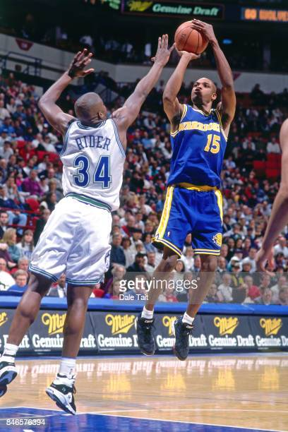 Latrell Sprewell of the Golden State Warriors shoots against the Minnesota Timberwolves circa 1995 at the Target Center in Minneapolis Minnesota NOTE...