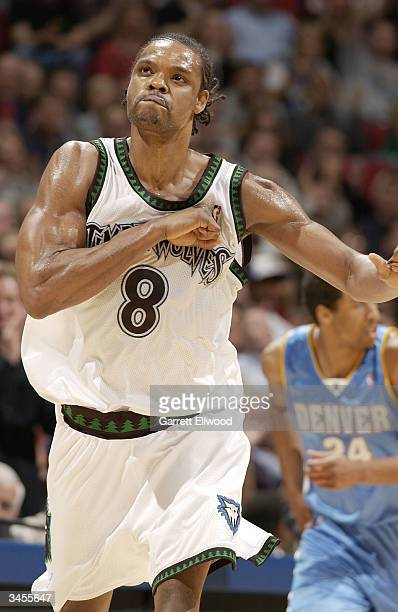 Latrell Sprewell of the Minnesota Timberwolves celebrates against the Denver Nuggets in game two of round one of the 2004 NBA Western Conference...