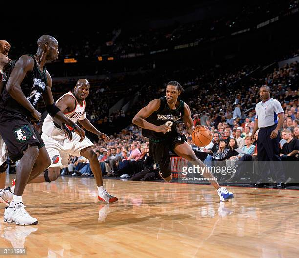 Latrell Sprewell of the Minnesota Timberwolves drives around Ruben Patterson of the Portland Trail Blazers during the game at The Rose Garden on...