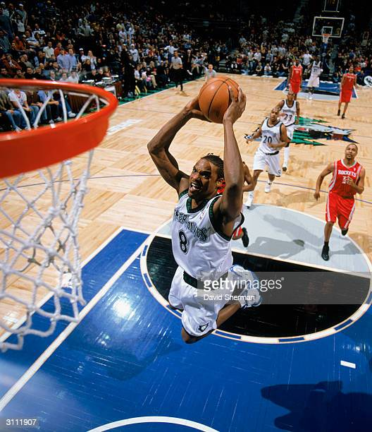 Latrell Sprewell of the Minnesota Timberwolves dunks the ball during the game against the Houston Rockets at the Target Center on March 5 2004 in...