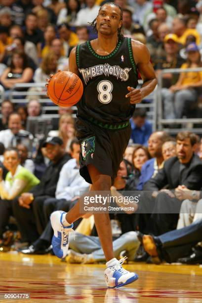 Latrell Sprewell of the Minnesota Timberwolves handles the ball against the Los Angeles Lakers in Game four of the Western Conference Finals during...