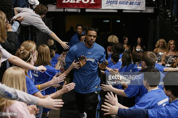 Latrell Sprewell of the Minnesota Timberwolves makes his way to the court as he greets children in the tunnel before the game against the New Jersey...