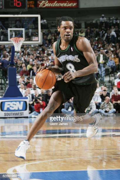Latrell Sprewell of the Minnesota Timberwolves moves the ball during the game against the Dallas Mavericks at American Airlines Arena on March 15...