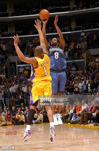 Latrell Sprewell of the Minnesota Timberwolves puts up a last second shot against Caron Butler of the Los Angeles Lakers on January 19 2004 at the...