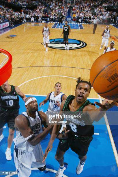 Latrell Sprewell of the Minnesota Timberwolves shoots against the Dallas Mavericks November 22 2004 at the American Airlines Center in Dallas Texas...