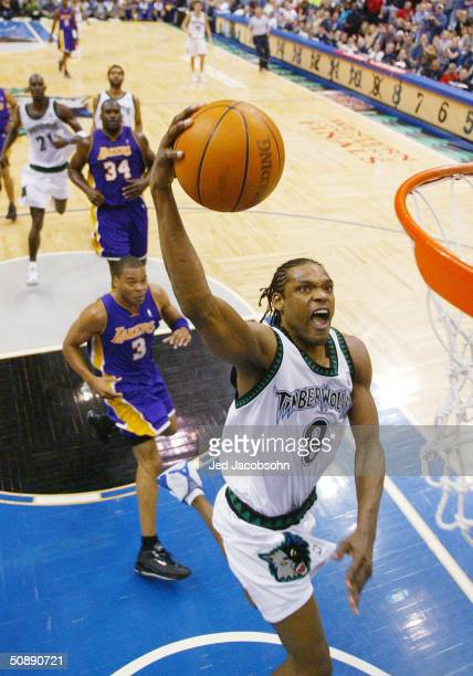Latrell Sprewell of the Minnesota Timberwolves slam dunks in the first half of Game two of the Western Conference Finals against the Los Angeles...